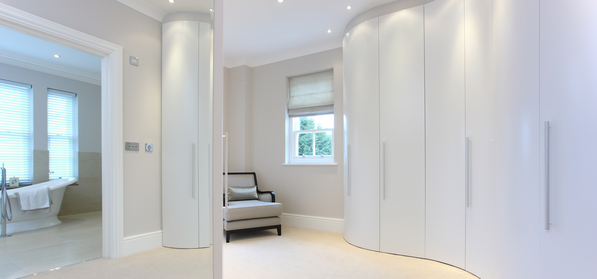 Matt white lacquer curved wardrobe