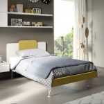 Yellow bed with shelving above